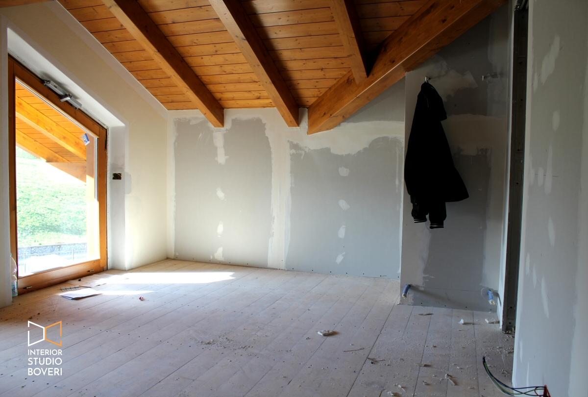 Arredamento camera da letto in mansarda stile rustico