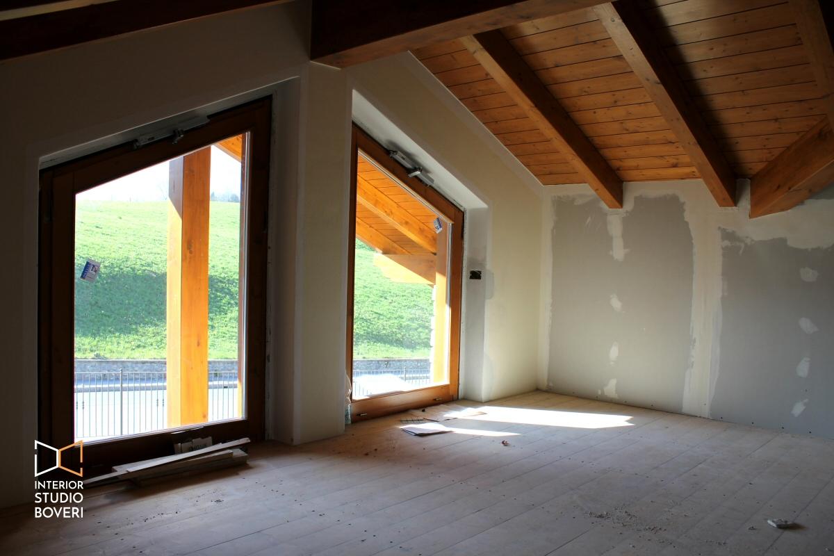 Arredamento camera da letto in mansarda stile rustico - Camino in camera da letto ...